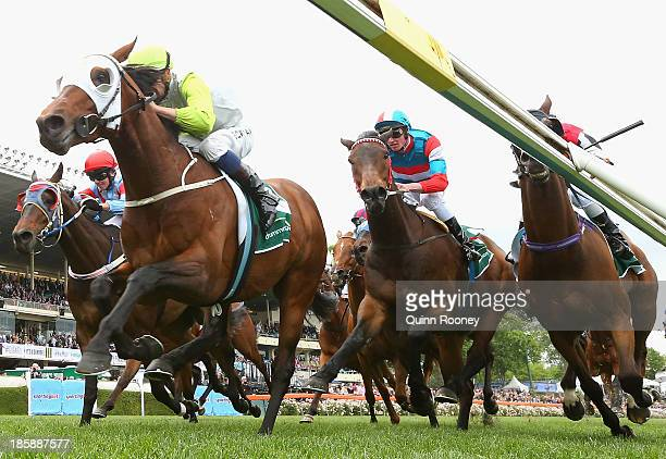 Hugh Bowman riding Hvasstan crosses the line to win the Drummond Golf Handicap during Cox Plate Day at Moonee Valley Racecourse on October 26 2013 in...