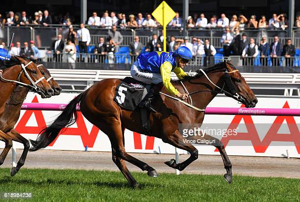 Hugh Bowman riding Le Romain wins Race 8 Cantala Stakes on Derby Day at Flemington Racecourse on October 29 2016 in Melbourne Australia