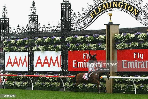 Hugh Bowman riding Lion Tamer crosses the line to win race Six AAMI Victoria Derby during Victoria Derby Day at Flemington Racecourse on October 30...