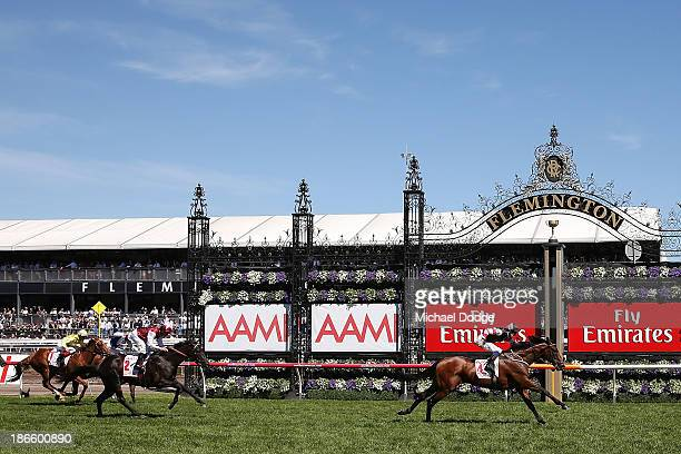Hugh Bowman riding Polanksi defeats Kerrin McEvoy on Complacent to win race 6 the AAMI Victoria Derby during Derby Day at Flemington Racecourse on...