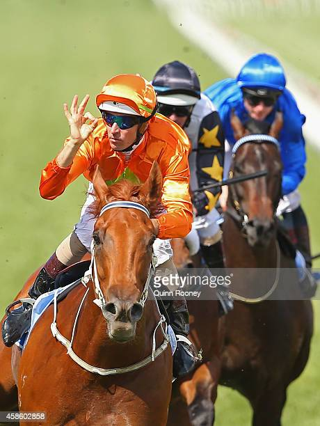 Hugh Bowman riding Terravista celebrates as he crosses the line to win race 6 the Darley Classic on Stakes Day at Flemington Racecourse on November 8...