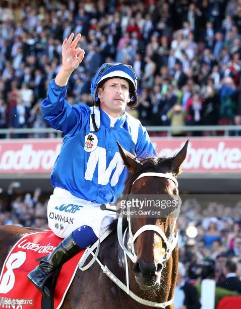 Hugh Bowman riding Winx celebrates after winning race nine the Ladbrokes Cox Plate during Cox Plate Day at Moonee Valley Racecourse on October 28...