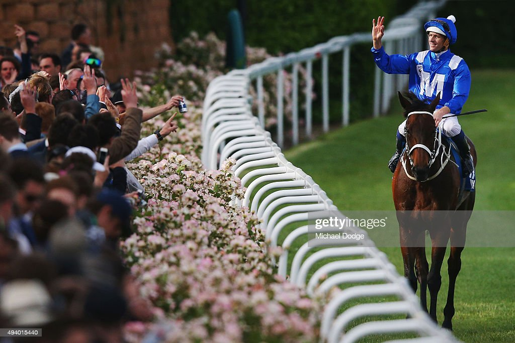 Hugh Bowman riding Winx celebrates with the crowd after winning race 9 The William Hill Cox plate during Cox Plate Day at Moonee Valley Racecourse on October 24, 2015 in Melbourne, Australia.
