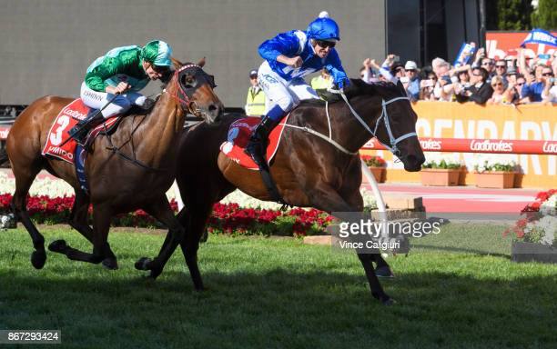 Hugh Bowman riding Winx defeats Blake Shinn riding Humidor in Race 9 Ladbrokes Cox Plate during Cox Plate Day at Moonee Valley Racecourse on October...