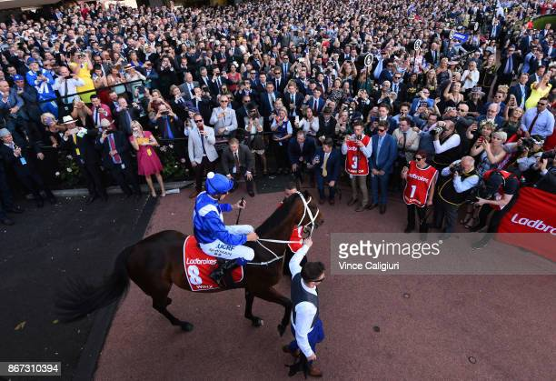 Hugh Bowman riding Winx walks out in front of a huge crowd before winning Race 9 Ladbrokes Cox Plate during Cox Plate Day at Moonee Valley Racecourse...