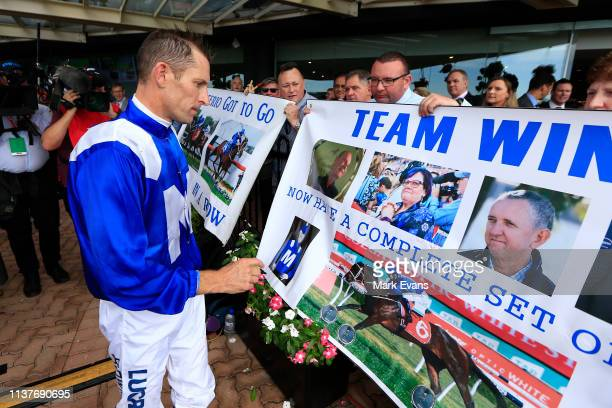 Hugh Bowman signs a banner after winning race 5 The Ranvet Stakes on Winx during Golden Slipper Day at Rosehill Gardens on March 23 2019 in Sydney...