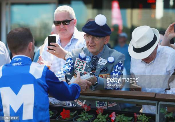 Hugh Bowman signs autographs to Winx fans after riding Winx in a barrier trial on Apollo Stakes Day at Royal Randwick Racecourse on February 17 2018...