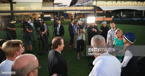 Hugh Bowman speaks to a large media contingent after riding Winx during a trackwork session at Rosehill Gardens on April 12 2018 in Sydney Australia