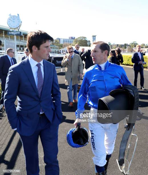 Hugh Bowman talks to trainer James Cummings after winning race 1 with Plague Stone during Sydney Racing at Royal Randwick Racecourse on July 21 2018...