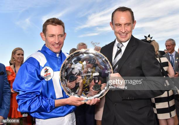 Hugh Bowman with Chris Waller after Winx won the Ladbrokes Cox Plate at Moonee Valley Racecourse on October 28 2017 in Moonee Ponds Australia
