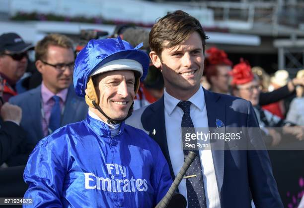 Hugh Bowman with James Cummings after Jorda won the Kennedy Plate at Flemington Racecourse on November 09 2017 in Flemington Australia