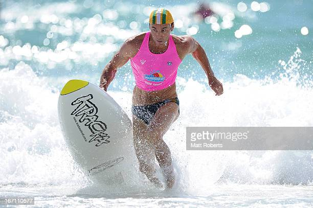 Hugh Dougherty of Tugun SLSC exits the water in the Open Men's Board Race final during the 2013 Australian National Surf Lifesaving Titles on April...