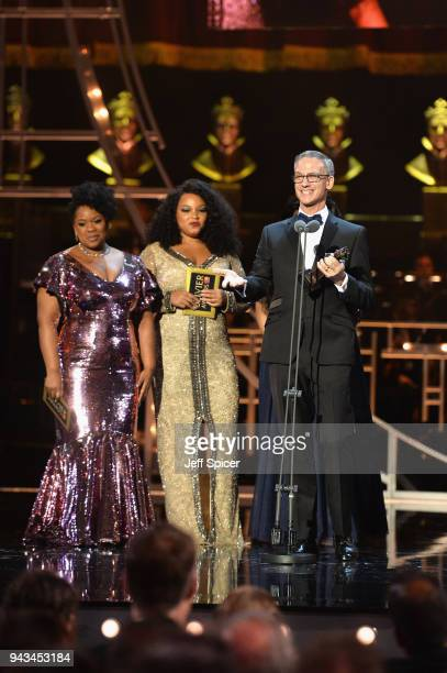 Hugh Durrant winner of the award for Best Costume Design for 'Dick Whittington' is seen on stage with Moya Angela Marisha Wallace and Karen Mav...
