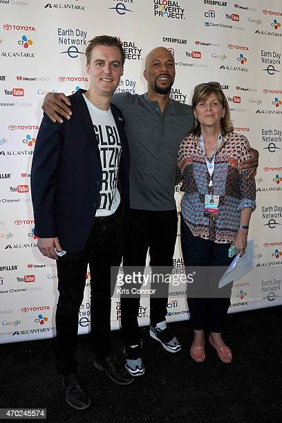 Hugh Evans, Common and Kathleen Rogers pose backstage during Global Citizen 2015 Earth Day on National Mall to end extreme poverty and solve climate...