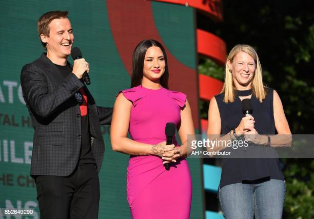 Hugh Evans Demi Lovato and Carolyn Miles speaks onstage during the 2017 Global Citizen Festival For Freedom For Justice For All in Central Park on...