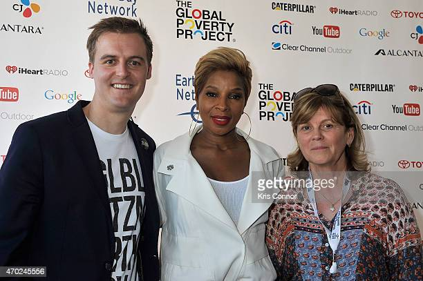 Hugh Evans, Mary J. Blige and Kathleen Rogers pose backstage during Global Citizen 2015 Earth Day on National Mall to end extreme poverty and solve...