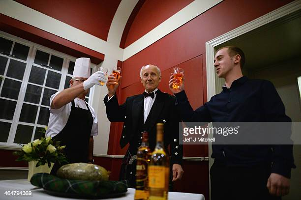 Hugh Farrell toasts the haggis at a Burns supper in the red room at Burns Cottage Pavilion on January 23 2014 in Alloway Scotland People around the...