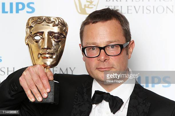 Hugh Fearnley Whittingstall poses with his Best Features Award in front of the winners boards at The Phillips British Academy Awards 2011 at The...