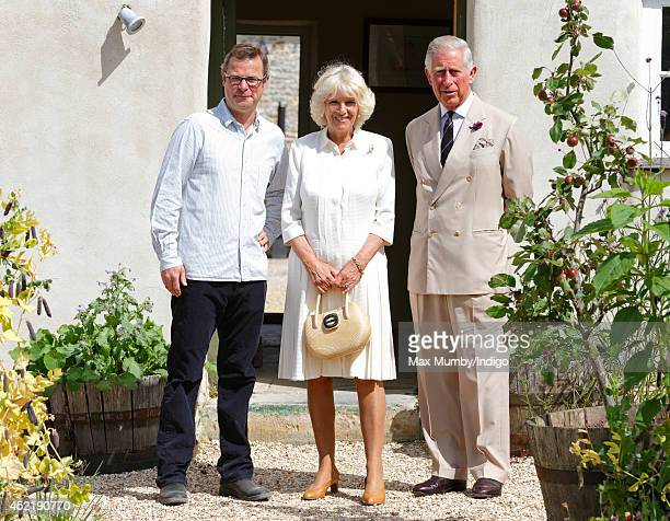 Hugh FearnleyWhittingstall poses for a photograph with Camilla Duchess of Cornwall and Prince Charles Prince of Wales as they tour River Cottage HQ...