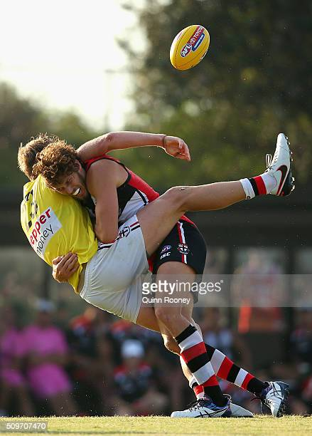 Hugh Goddard of the Saints is tackled by Tom Hickey during the St Kilda Saints AFL IntraClub Match at Trevor Barker Beach Oval on February 12 2016 in...