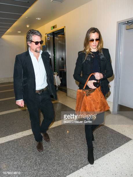 Hugh Grant and Anna Eberstein are seen at Los Angeles International Airport on January 07, 2019 in Los Angeles, California.