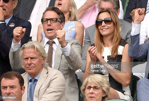 Hugh Grant and Anna Eberstein attend day 13 of the Wimbledon Tennis Championships at Wimbledon on July 12 2015 in London England