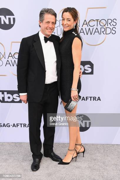 Hugh Grant and Anna Eberstein attend the 25th Annual Screen Actors Guild Awards at The Shrine Auditorium on January 27 2019 in Los Angeles California