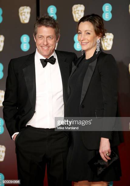 Hugh Grant and Anna Eberstein attend the EE British Academy Film Awards held at Royal Albert Hall on February 18 2018 in London England