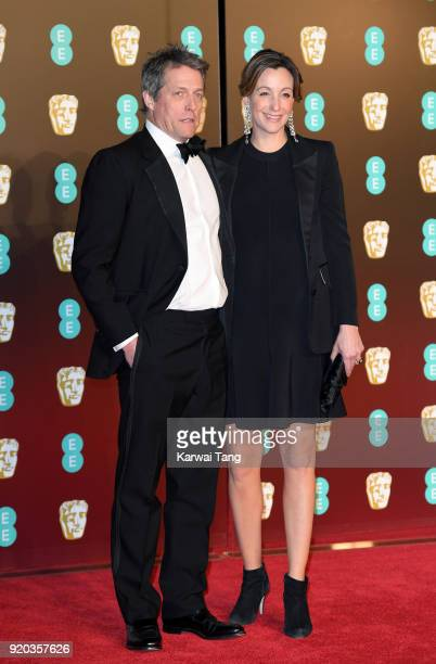 Hugh Grant and Anna Eberstein attend the EE British Academy Film Awards held at the Royal Albert Hall on February 18 2018 in London England