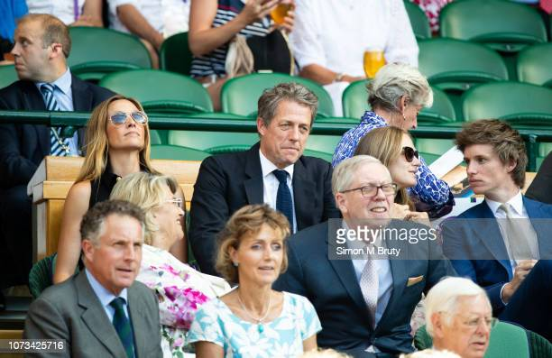 Hugh Grant and Anna Eberstein attend the Mens Single Final during The Wimbledon Lawn Tennis Championship at the All England Lawn Tennis and Croquet...