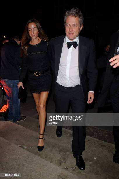 Hugh Grant and Anna Eberstein seen arriving at the Freemason's Hall in Covent Garden for the afterparty for the film premiere of The Irishman on...