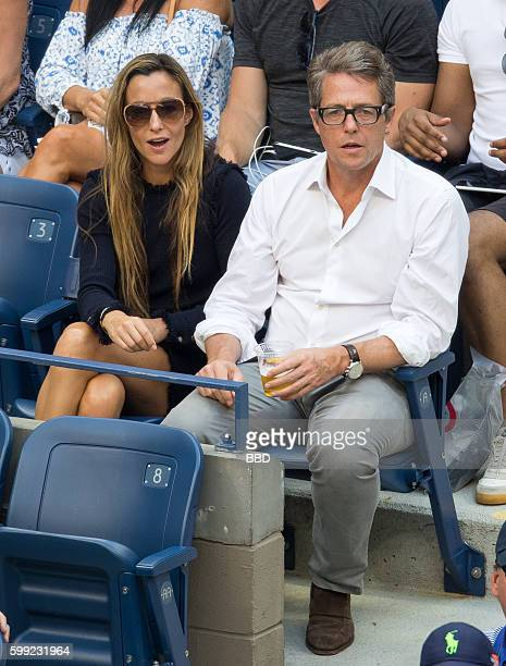 Hugh Grant and Anna Eberstein seen at USTA Billie Jean King National Tennis Center on September 4 2016 in the Queens borough of New York City