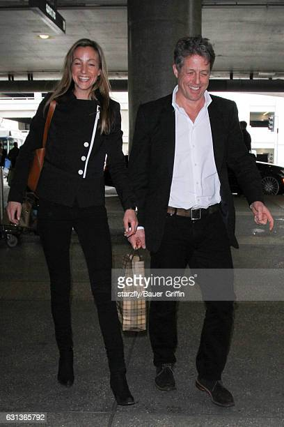 Hugh Grant and Anna Elisabet Eberstein are seen at LAX on January 09 2017 in Los Angeles California