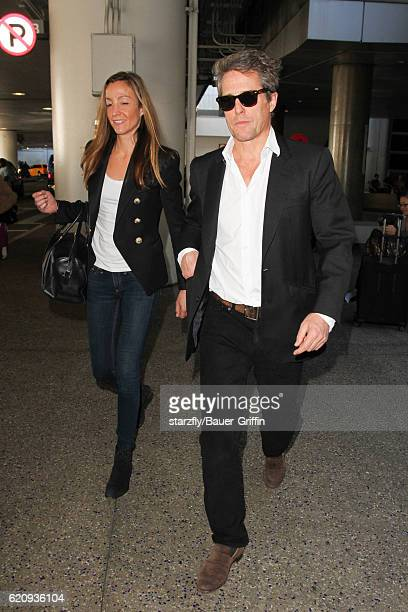 Hugh Grant and Anna Elisabet Eberstein are seen at LAX on November 03 2016 in Los Angeles California