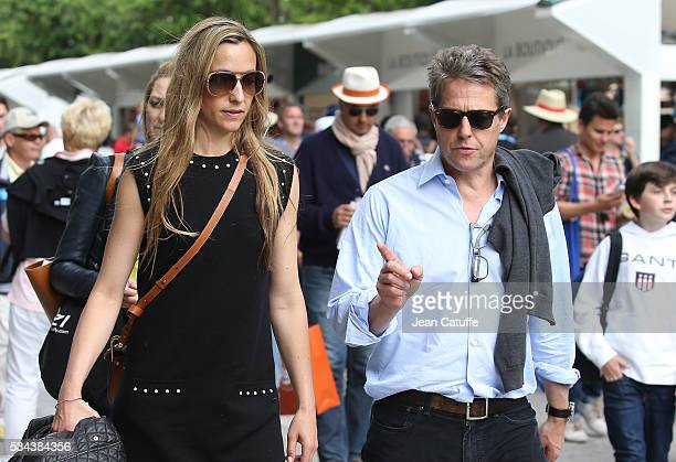 Hugh Grant and Anna Elisabet Eberstein attend Andy Murray's match on day 4 of the 2016 French Open held at RolandGarros stadium on May 25 2016 in...