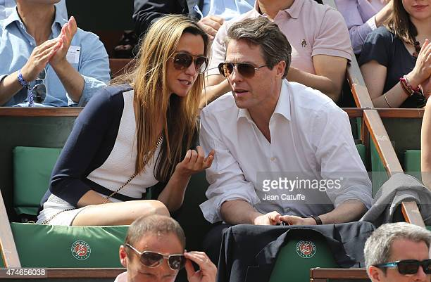 Hugh Grant and Anna Elisabet Eberstein attend day 1 of the French Open 2015 held at Roland Garros on May 24 2015 in Paris France