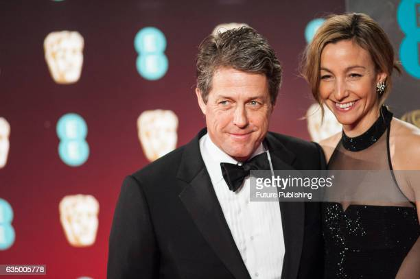 Hugh Grant and Anna Elisabet Eberstein attend the 70th British Academy Film Awards ceremony at the Royal Albert Hall on February 12 2017 in London...