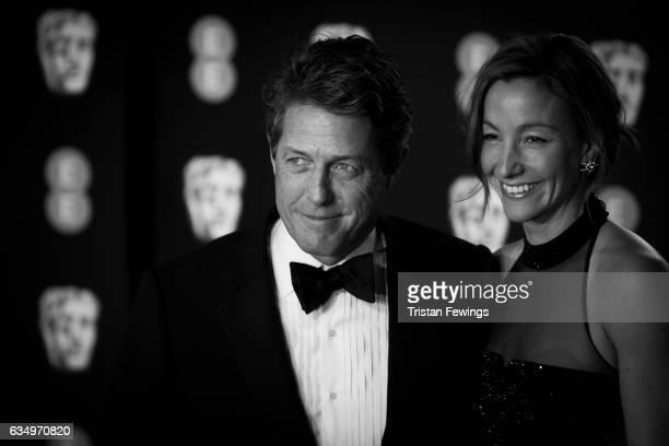 Hugh Grant and Anna Elisabet Eberstein attend the 70th EE British Academy Film Awards at Royal Albert Hall on February 12 2017 in London England