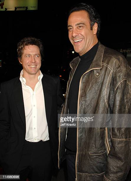 Hugh Grant and Brad Garrett during 'Music and Lyrics' Los Angeles Premiere Red Carpet at Grauman's Chinese Theater in Hollywood California United...