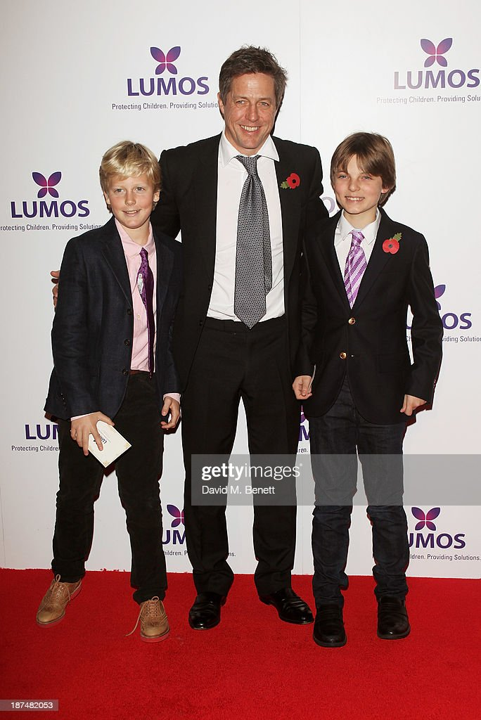Hugh Grant (C) and Damian Hurley, son of Elizabeth Hurley, attend the Lumos fundraising event hosted by J.K. Rowling at The Warner Bros. Harry Potter Tour on November 9, 2013 in London, England.