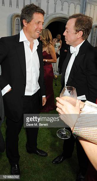 Hugh Grant and Geordie Greig attend the Raisa Gorbachev Foundation Party at Stud House Hampton Court Palace on June 5 2010 in Richmond upon Thames...
