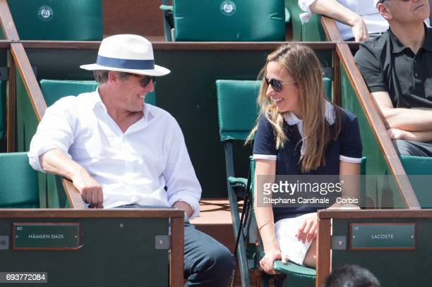 Hugh Grant and his companion Anna Eberstein attend the French Tennis Open 2017 Day Twelve at Roland Garros on June 8 2017 in Paris France