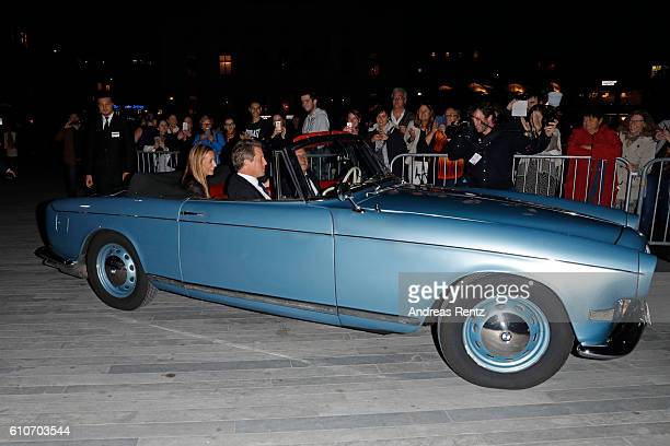 Hugh Grant and his girlfriend Anna Eberstein arrive in an oldtimer at the 'Florence Foster Jenkins' Premiere and Golden Icon award ceremony during...