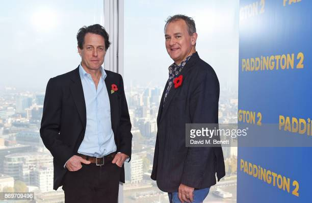 Hugh Grant and Hugh Bonneville attend a photocall for Paddington 2 at ShangriLa Hotel The Shard on November 3 2017 in London England