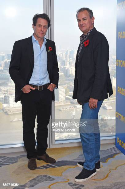 Hugh Grant and Hugh Bonneville attend a photocall for 'Paddington 2' at ShangriLa Hotel The Shard on November 3 2017 in London England