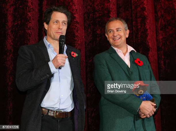 Hugh Grant and Hugh Bonneville attend the 'Paddington 2' premiere at Zoo Palast on November 12 2017 in Berlin Germany