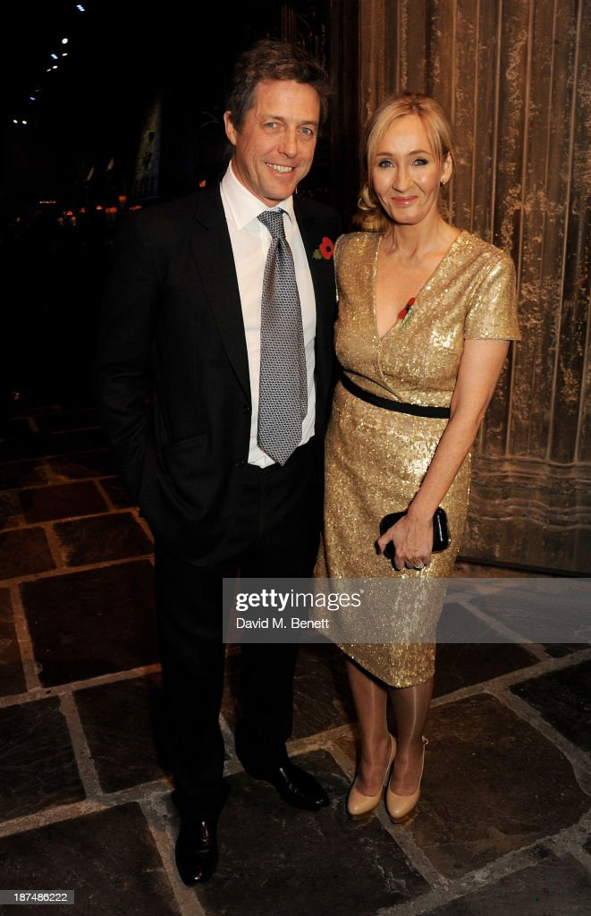 Hugh Grant (L) and J.K. Rowling attend the Lumos fundraising event hosted by J.K. Rowling at The Warner Bros. Harry Potter Tour on November 9, 2013 in London, England.