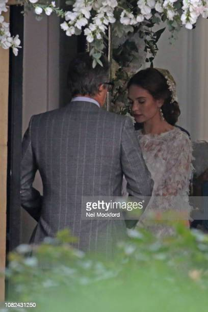 Hugh Grant and Lily James seen filming 'Four Weddings and a Funeral' at a church in North London for Comic Relief titled 'One Red Nose Day and a...
