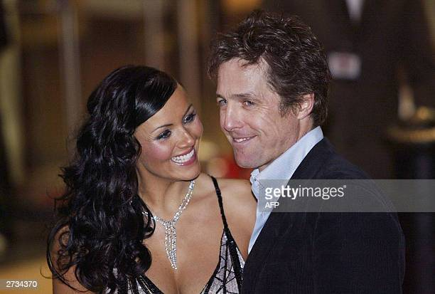 "Hugh Grant and Martine McCutcheon arrive for the UK premiere of the film ""Love Actually"", at the Odeon Cinema, Leicester Square in London, 16..."