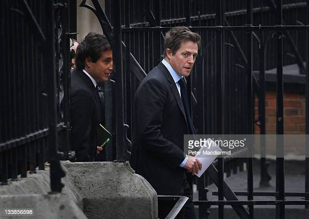 Hugh Grant arrives with David Sherborne QC to give evidence at The Leveson Inquiry at The Royal Courts of Justice on November 21 2011 in London...